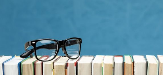 front-view-books-with-glasses_23-2148255824